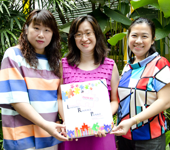 (From left) Jalene, Dawn and Indriana with the Science Assessment for Learning (AfL) package they developed. It contains a variety of AfL tools that teachers can readily use in the classroom.